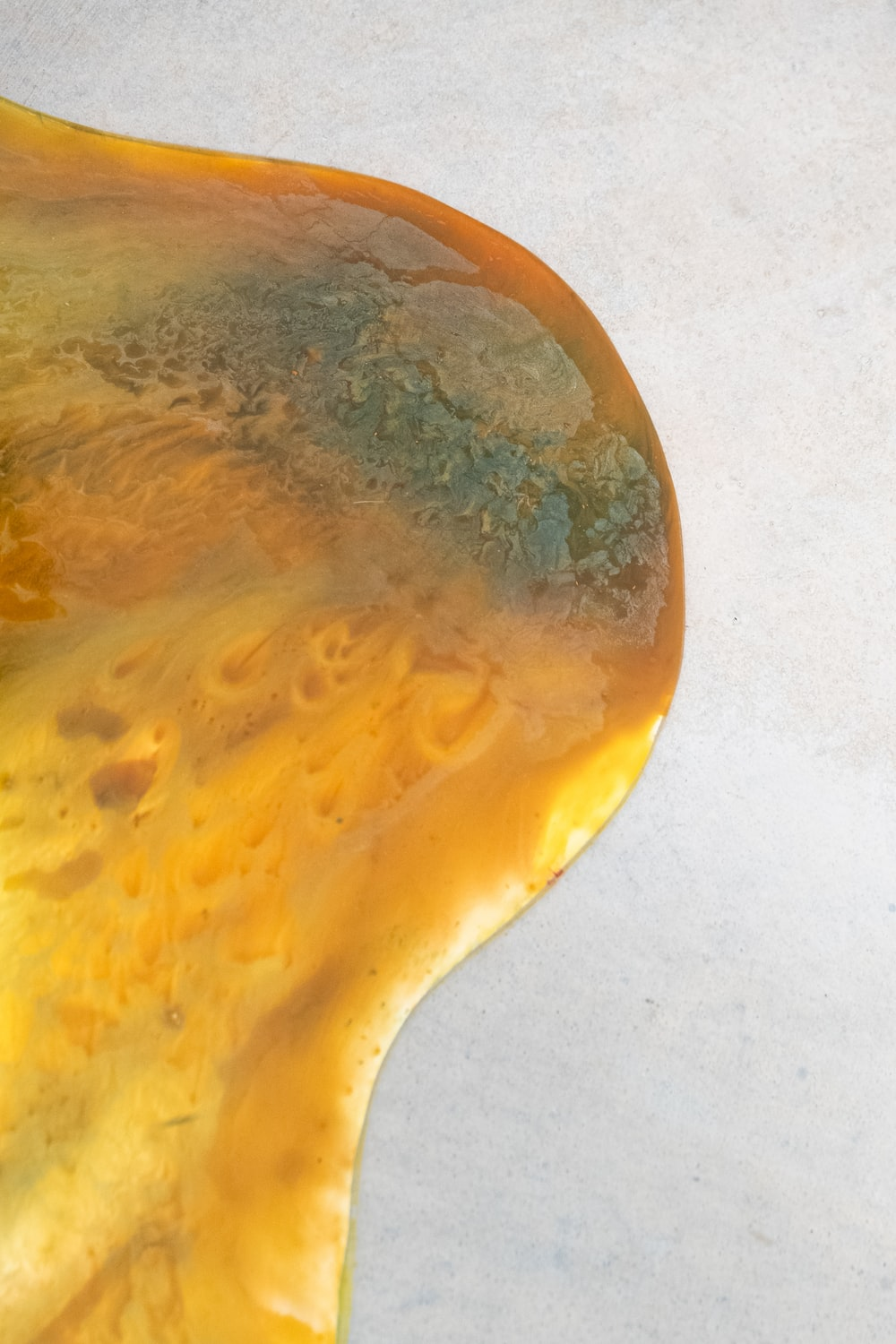gold liquid on white surface