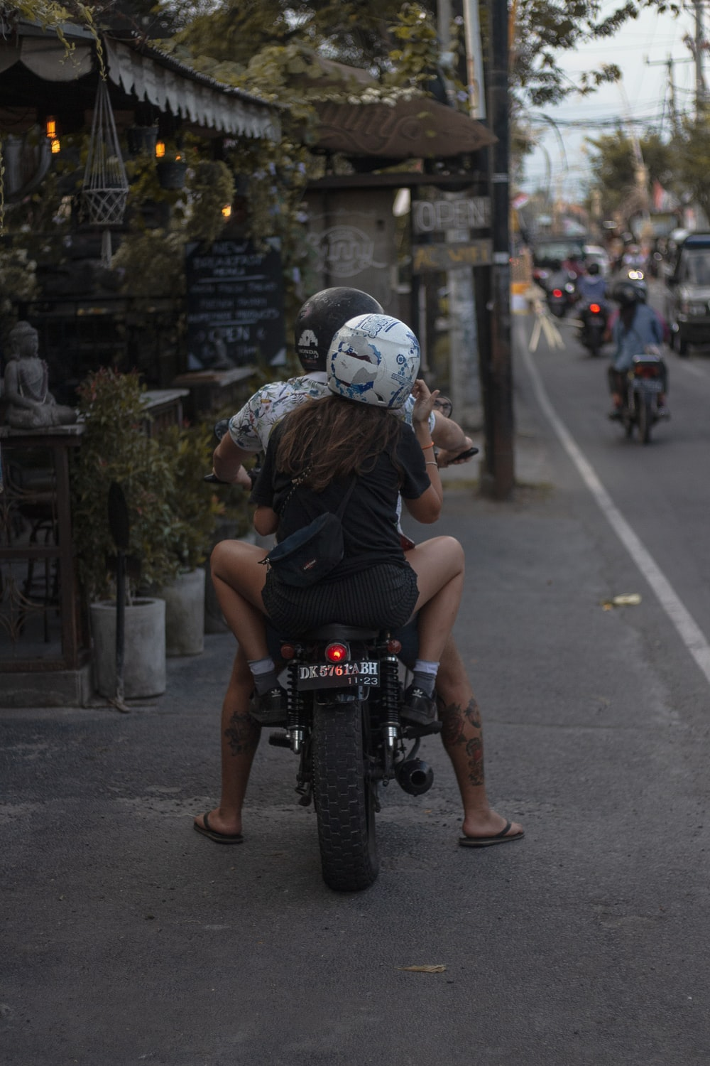 couple riding on the motorcycle
