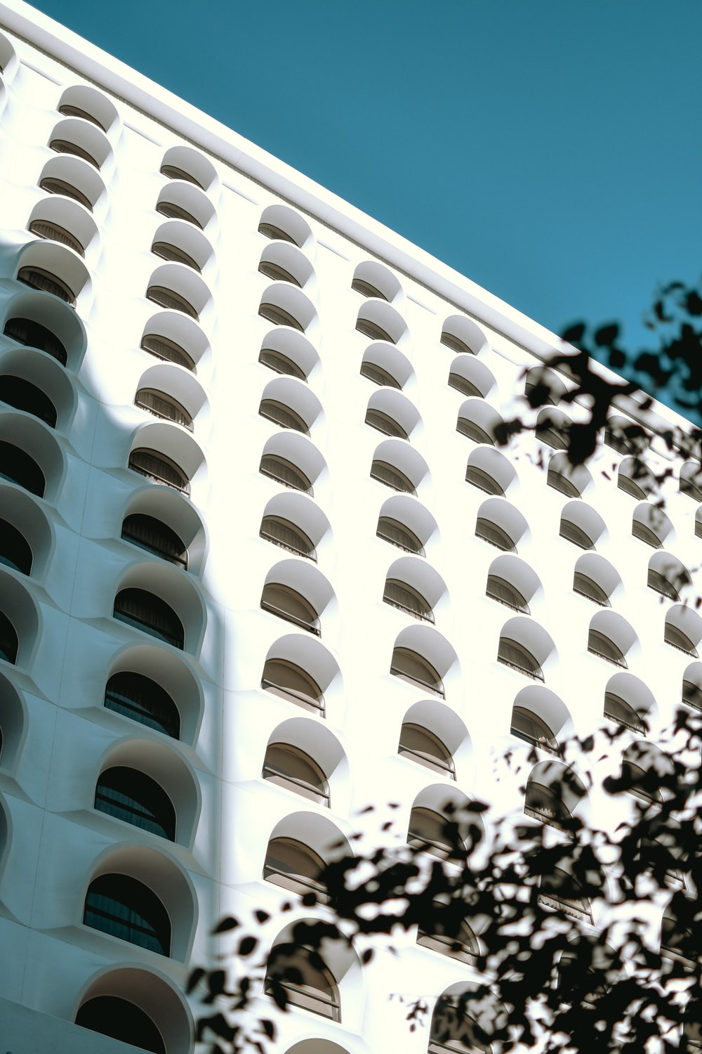 white concrete multi-story building during daytime