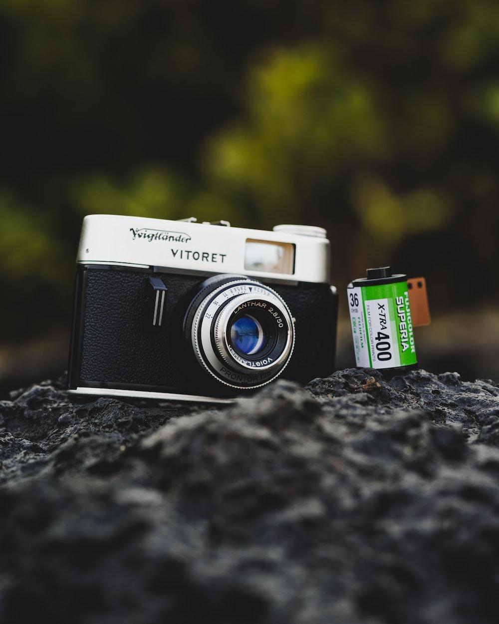 black and silver Vitoret bridge camera near film camera