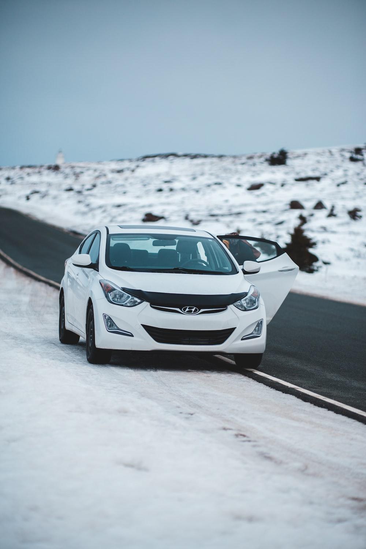 white Hyundai parked beside road