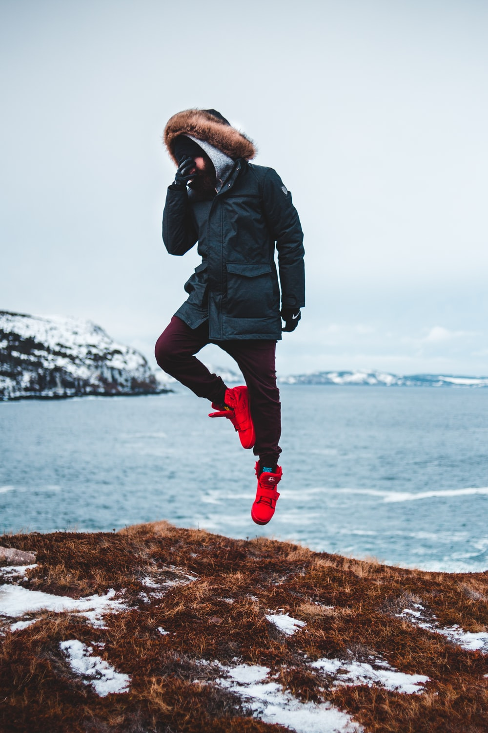 jumpshot photography of man in a mountain cliff