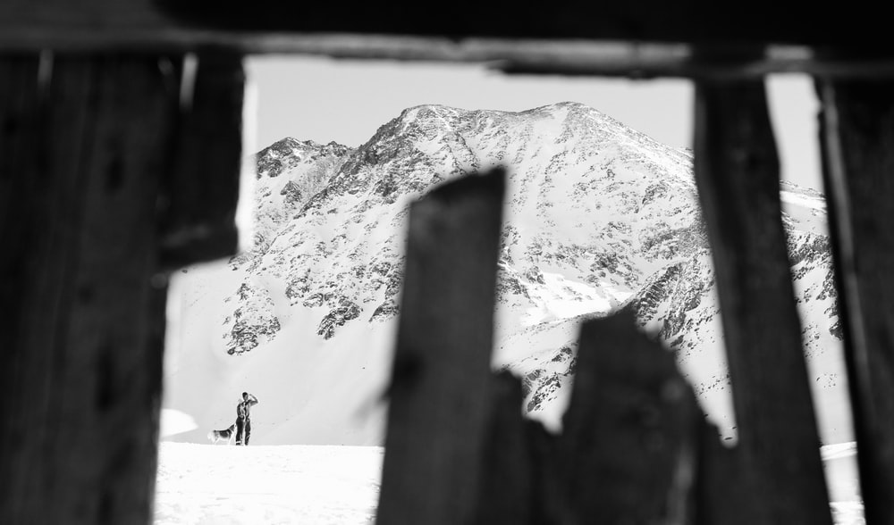 man standing near the snowy mountain photograph