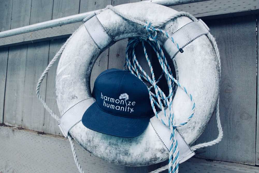 fitted cap on swim ring by wooden panel