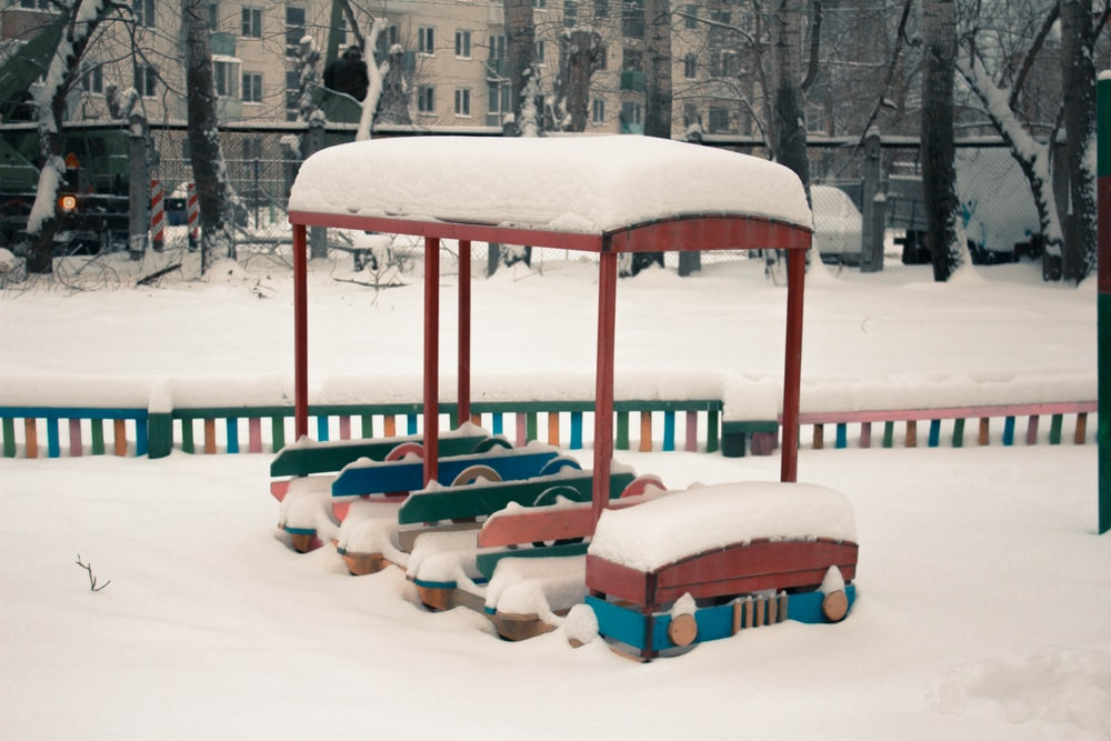 snow-covered bus ride-on toy