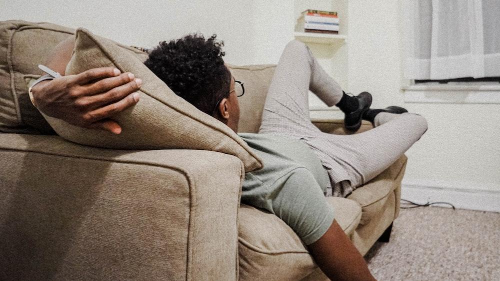 man lying on the sofa
