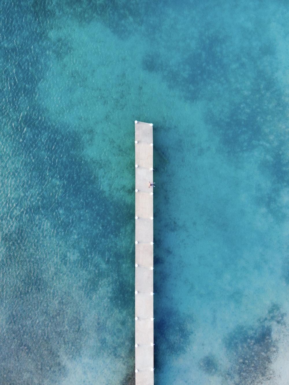 white wooden ocean dock