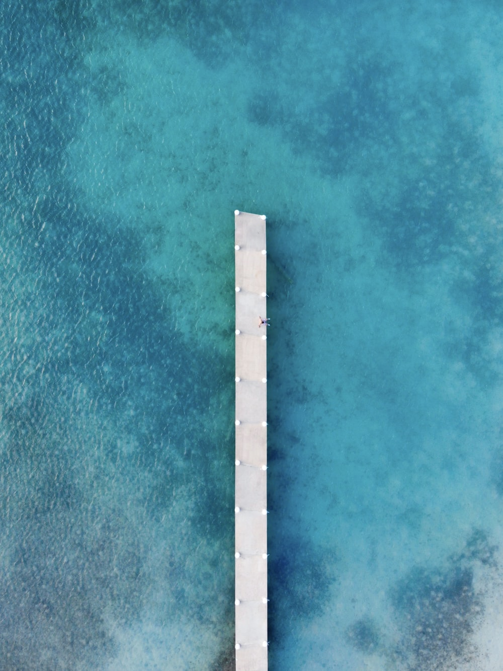 white wooden ocean dock