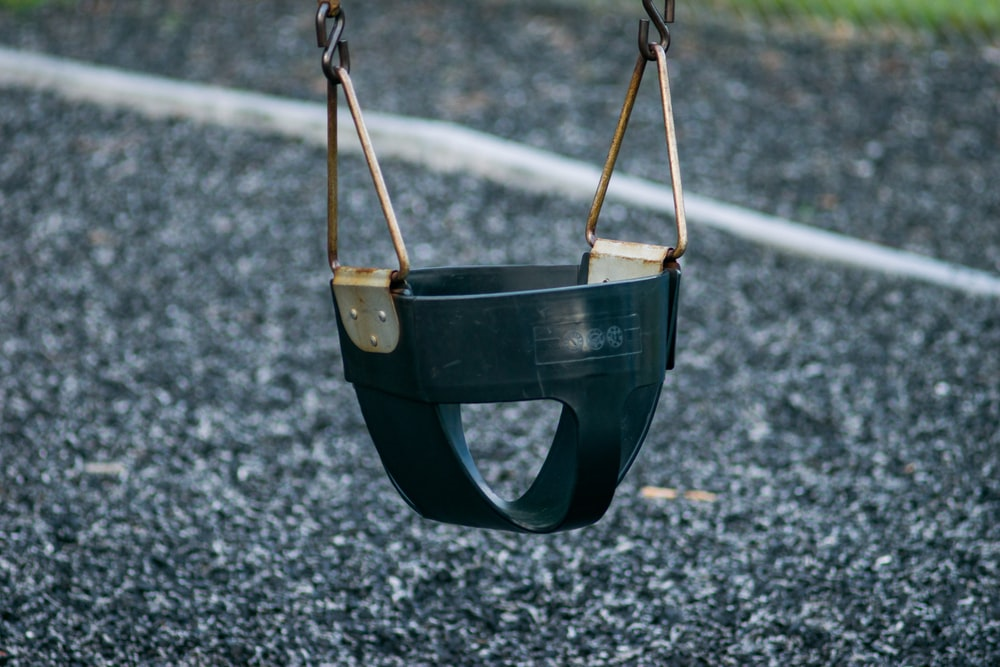 black plastic wearable hanging chair