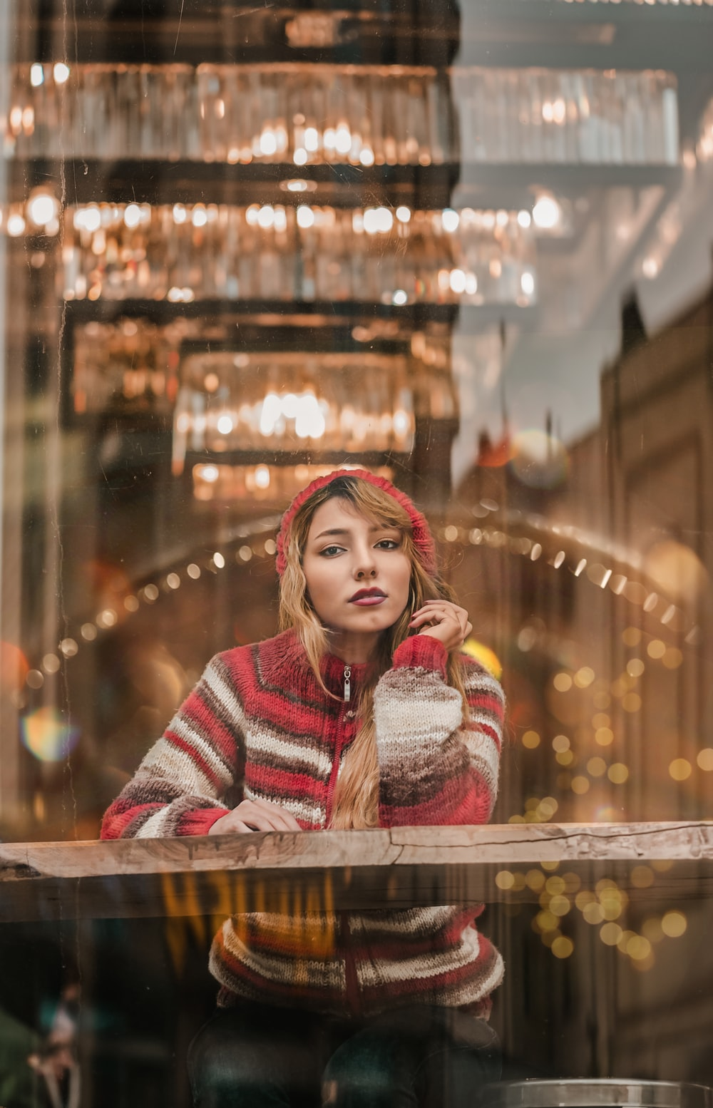 woman wearing red and white stripe zip-up hoodie