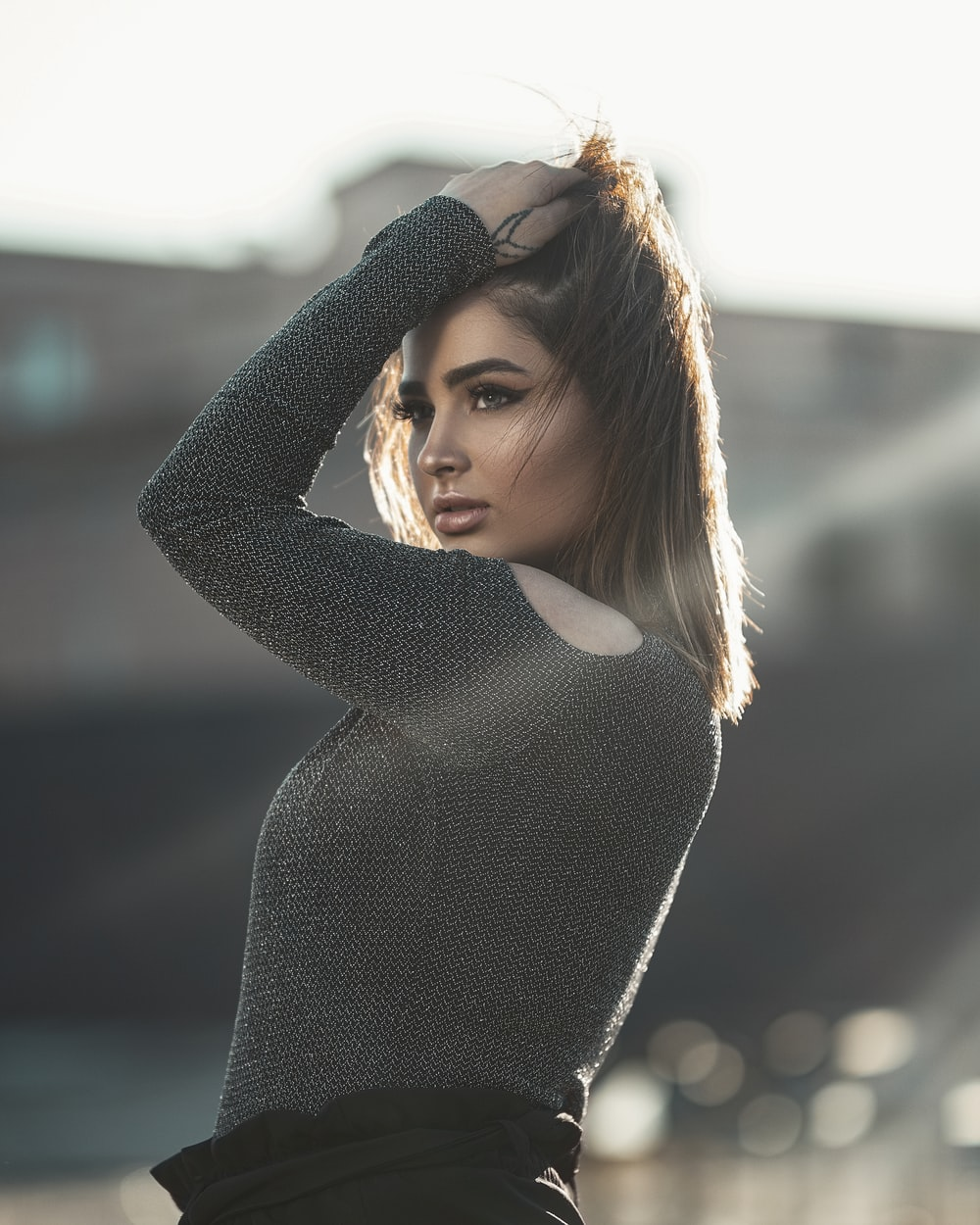 photo shoot of woman touching her hair