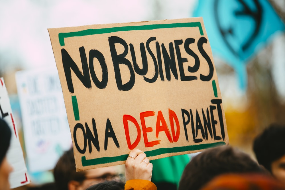 no business on a dead planet sign
