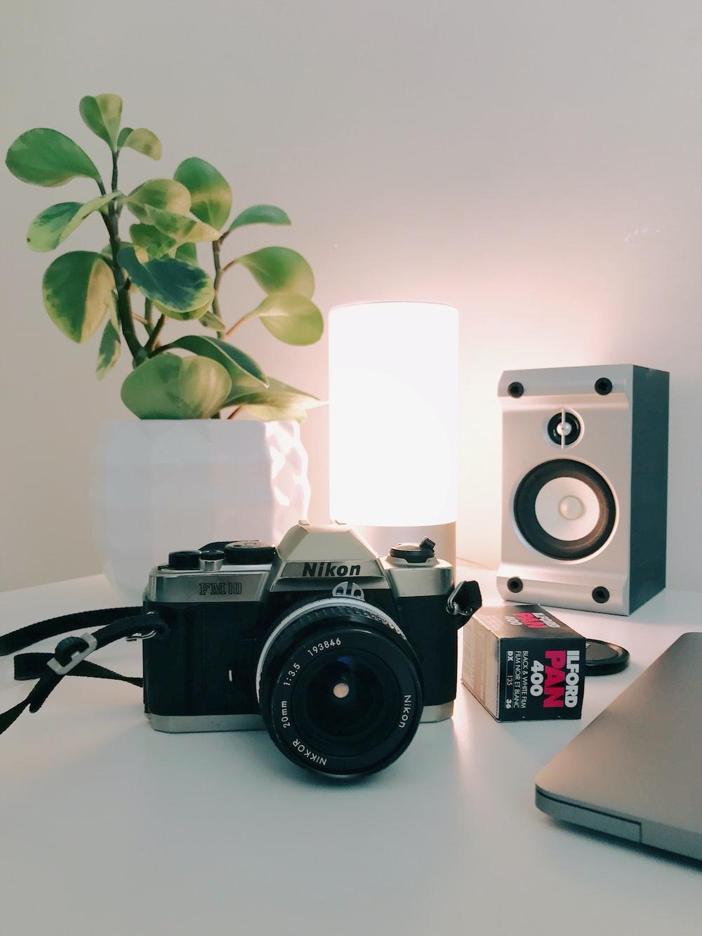 black and grey Nikon camera