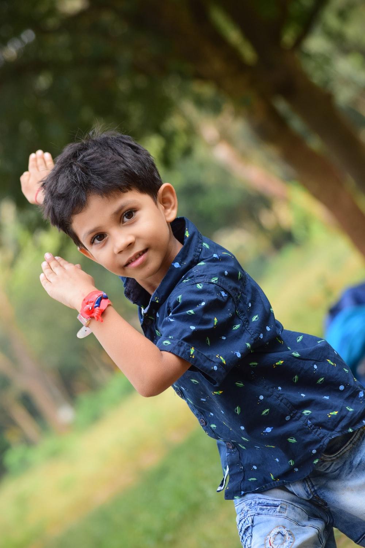 toddler raising both arms