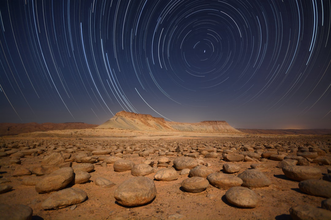 In A Galaxy Far, Far Away  bulbusim Field - Israel  still Looking For the English Name of This Site and the Name of This Stones  in Hebrew: Bulbus    480 Photos 15sec Exposure and 10 Sec Interval = 3:20 Hour Exposure  nikon D7100 sigma 10-20mm F/4.0 iso40 - unsplash