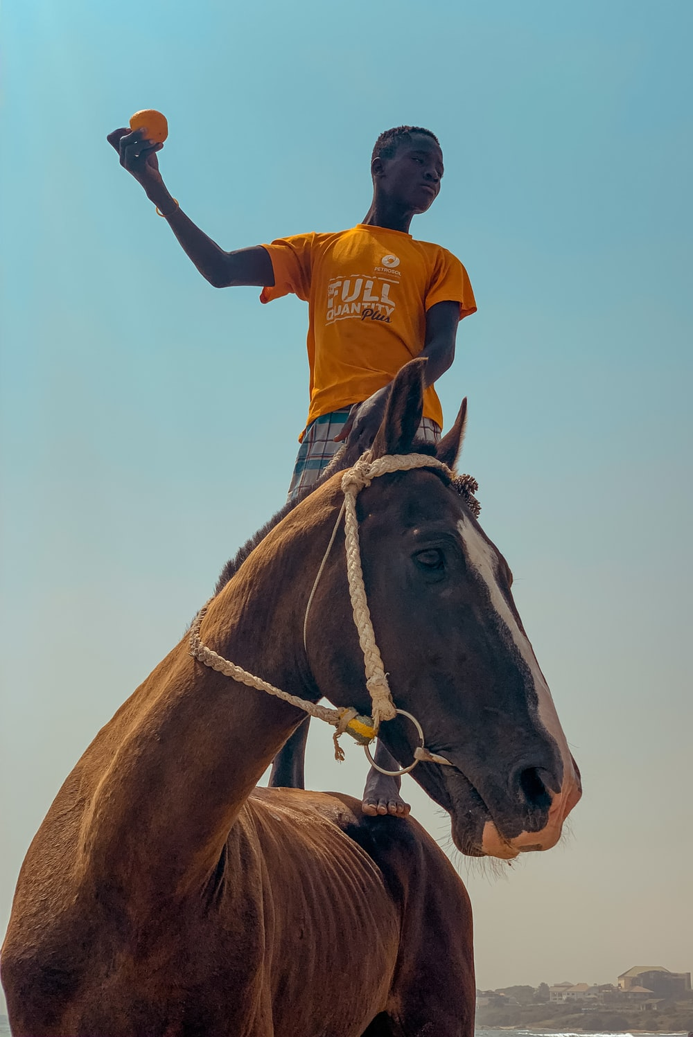 man standing on the horse