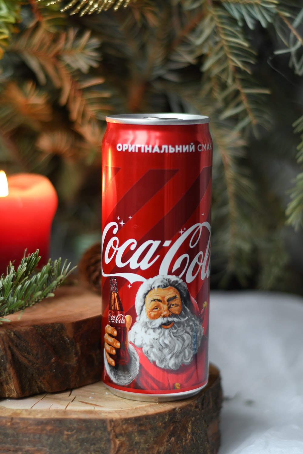 red Coca-Cola soda can on wood slice