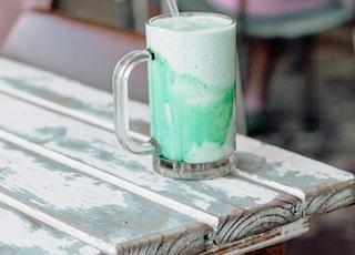 clear glass mug with ice cream