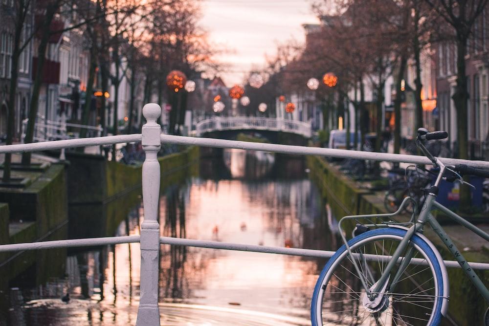 parked bike beside railing