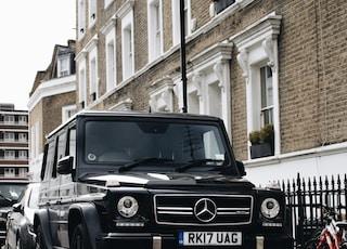 black Mercedes-Benz SUV parked beside road