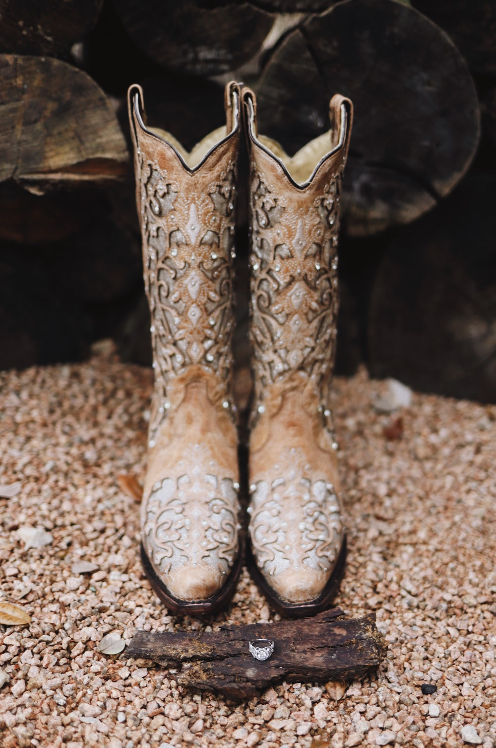 pair of brown leather cowboy boots near plank