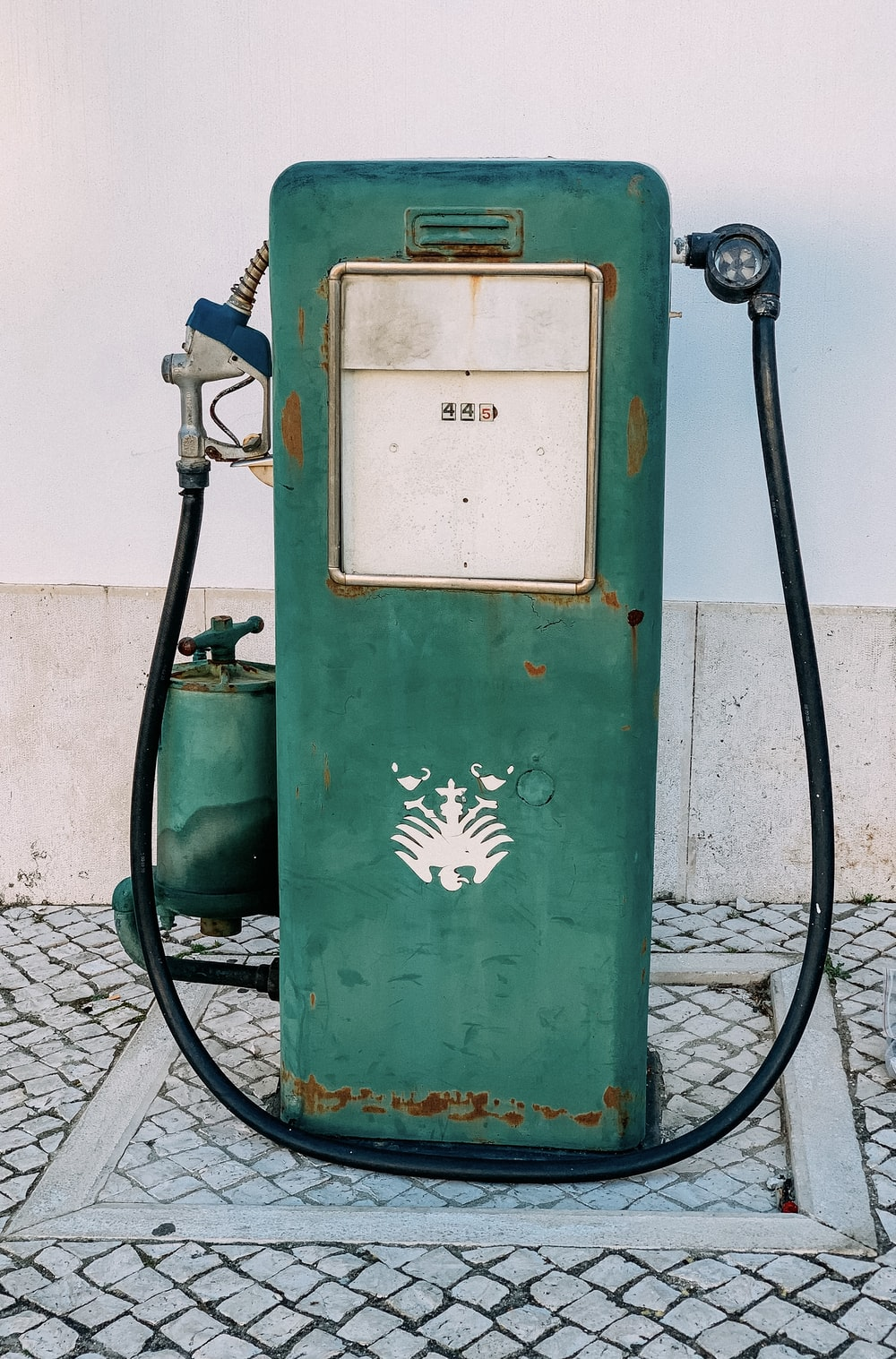 green and white gas pump