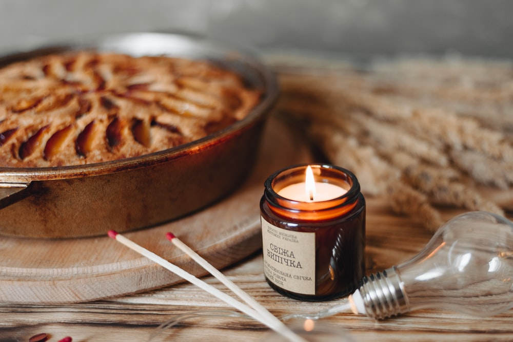 lit candle beside baked pie