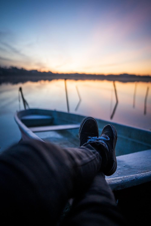 person sitting near boat