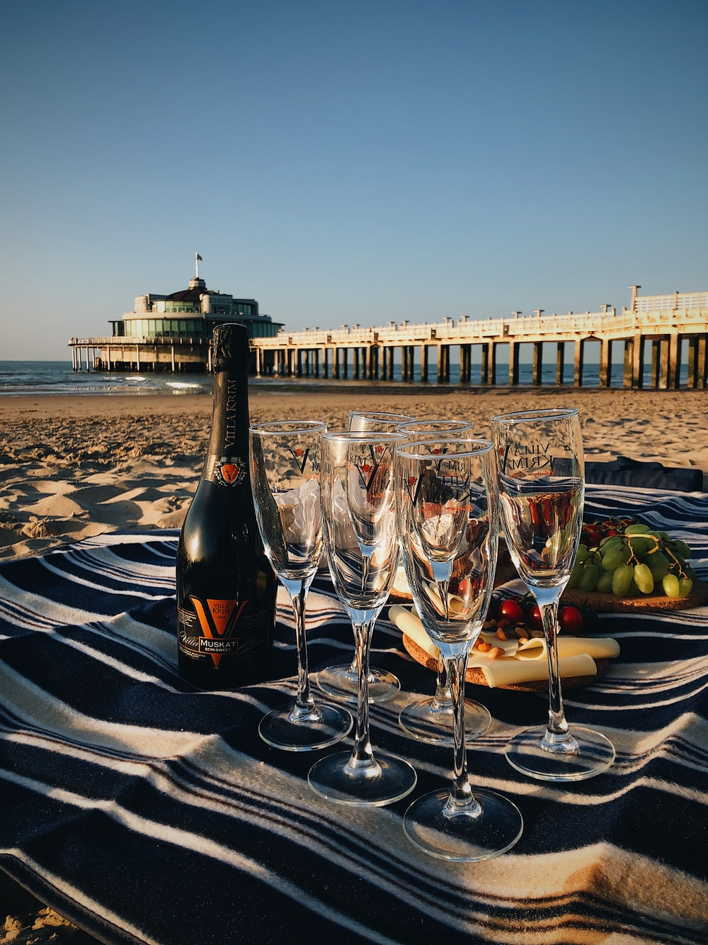 champagne glasses on table at beach