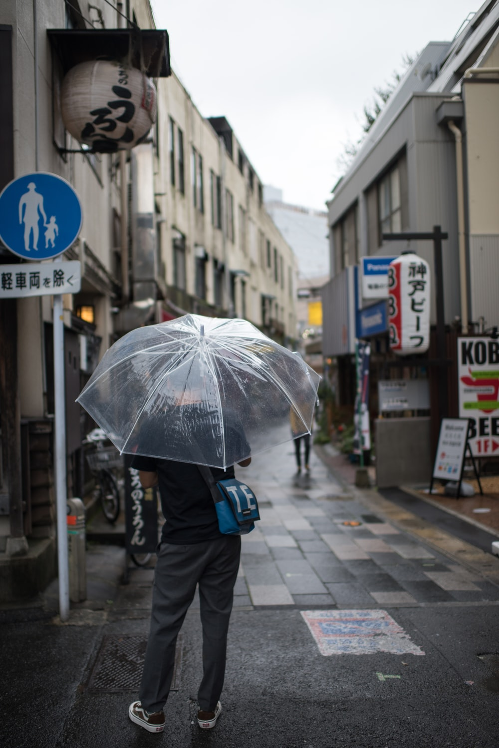 man using clear plastic umbrella