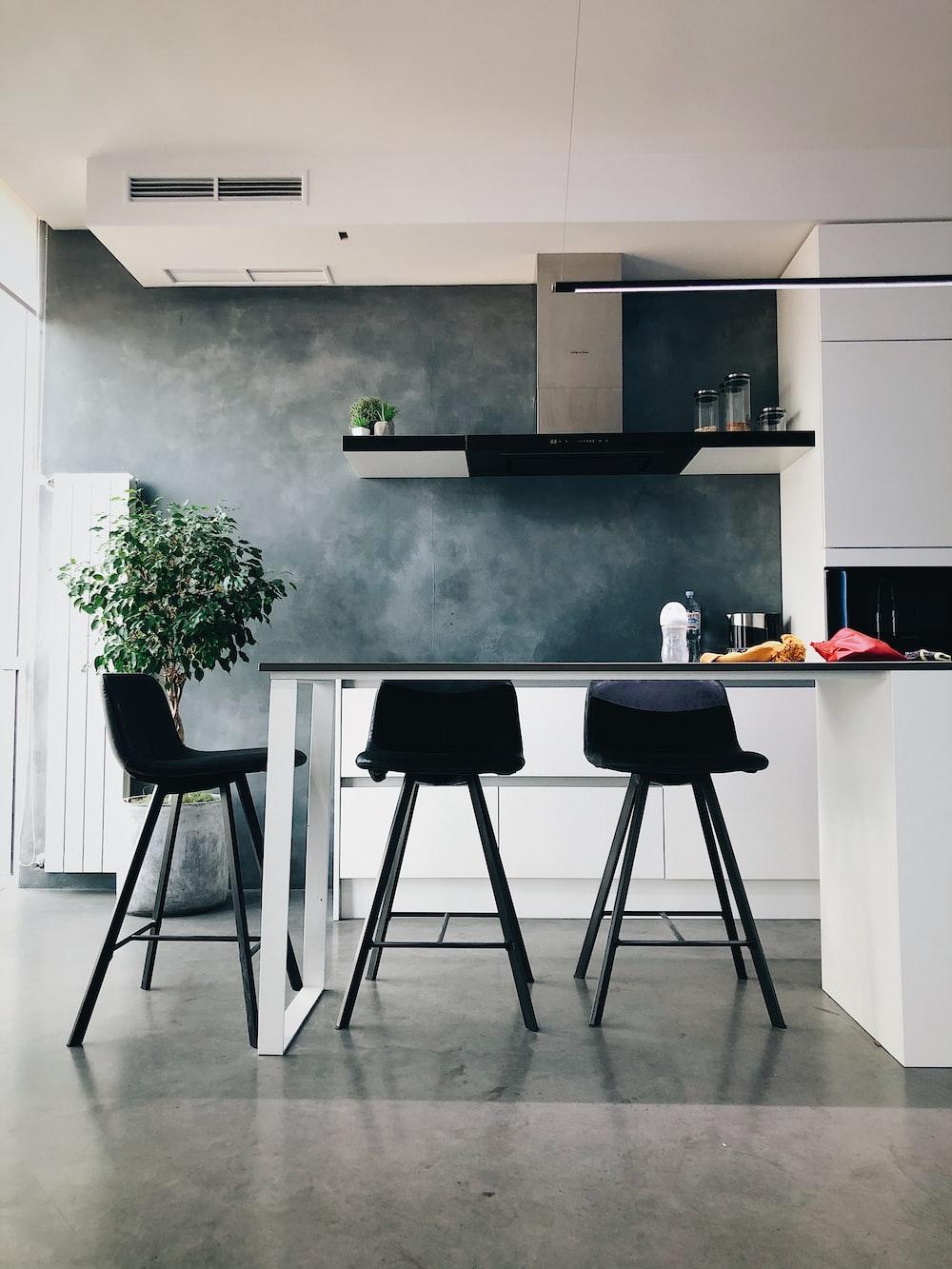 three black stools in kitchen