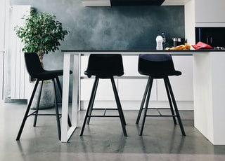 three black stools in kitchen
