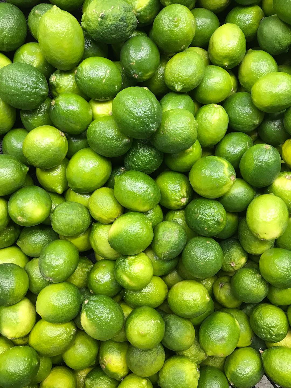 A pile of green lemons
