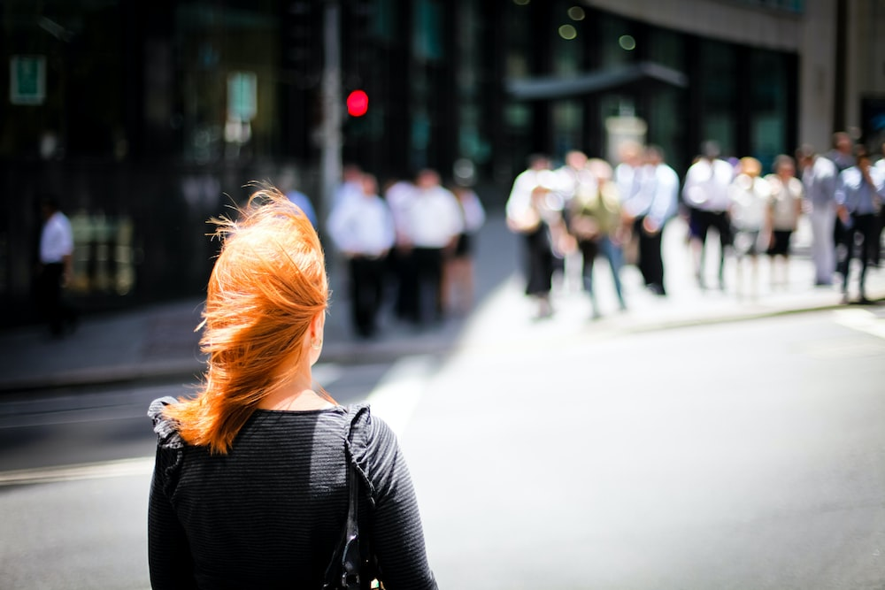 selective focus photography of woman in black top