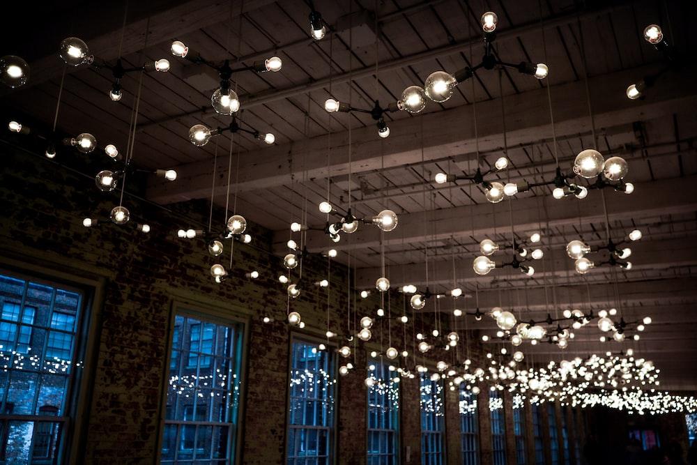 Lighted Round Ceiling Light Fixtures Inside Building Photo Free Lighting Image On Unsplash
