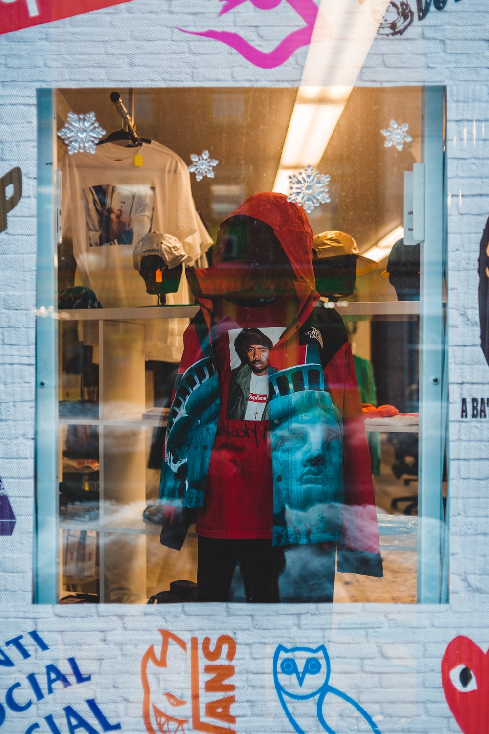 red hoodie displayed inside shop by the window