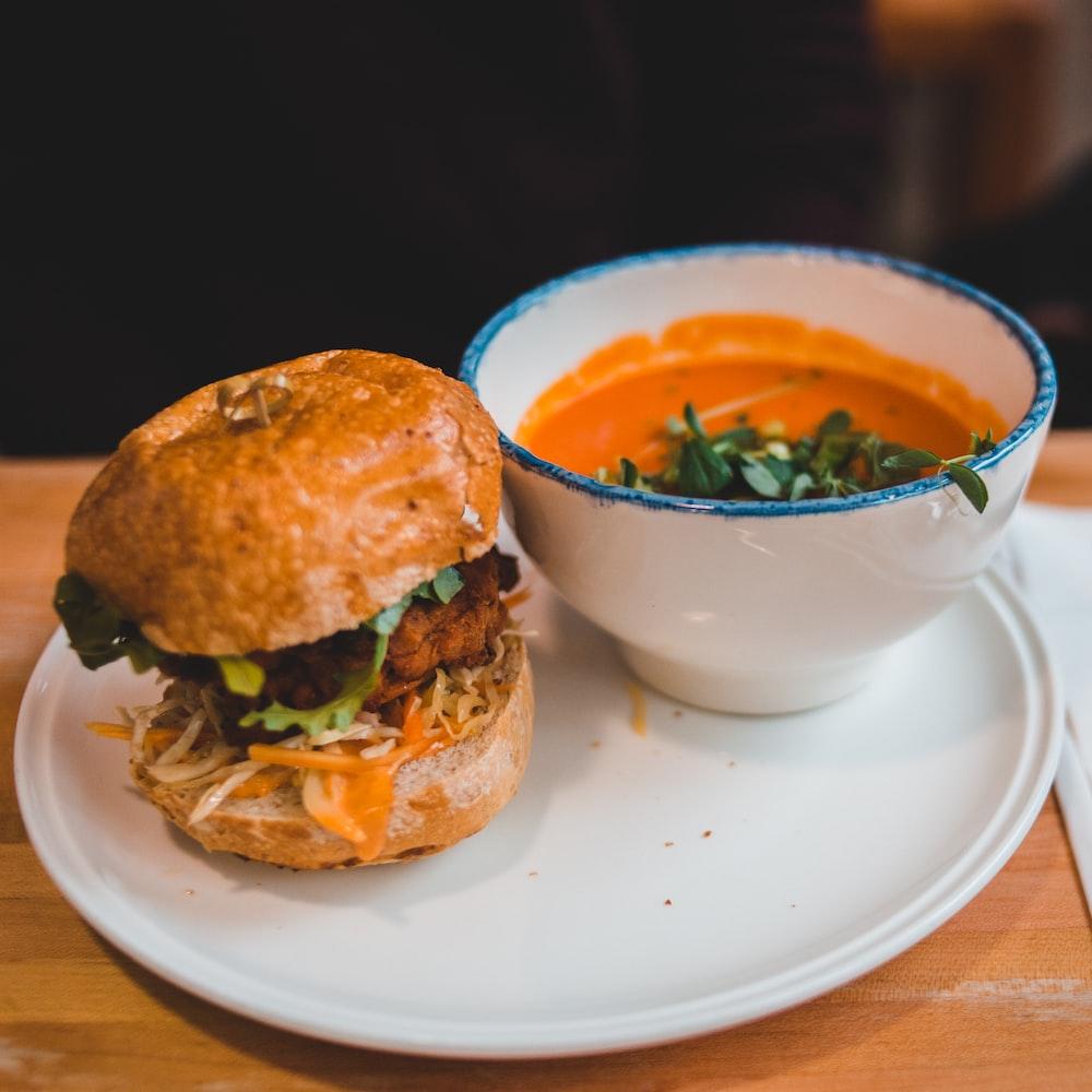 hamburger beside bowl of food