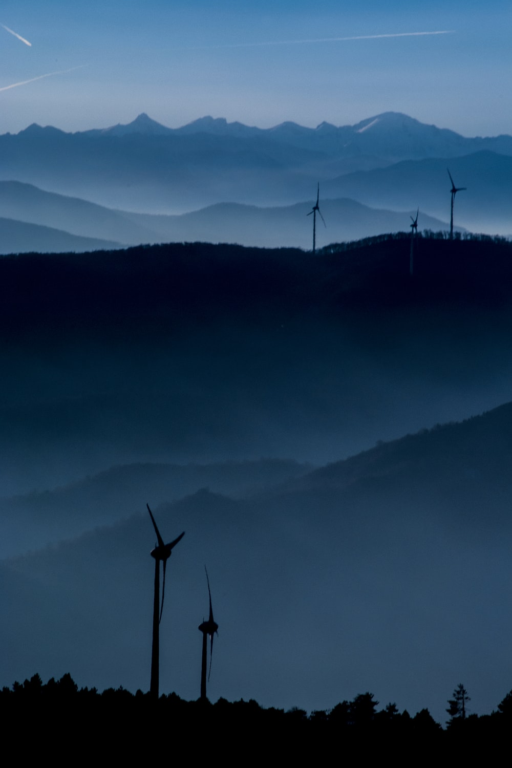wind turbine overlooking mountain ridge