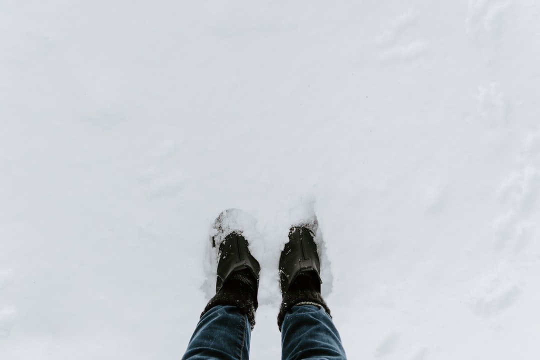 Boots In Solid White Snow - unsplash