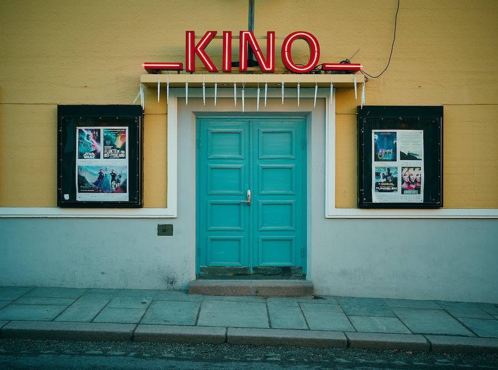 minimalist photography of teal Kino door