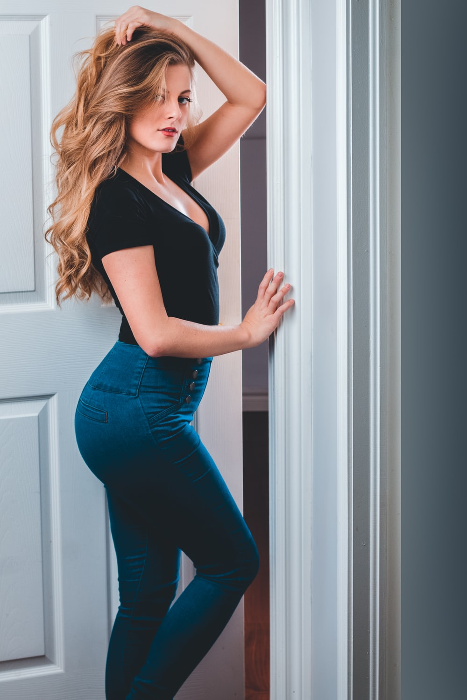 woman wearing black blouse standing near the door