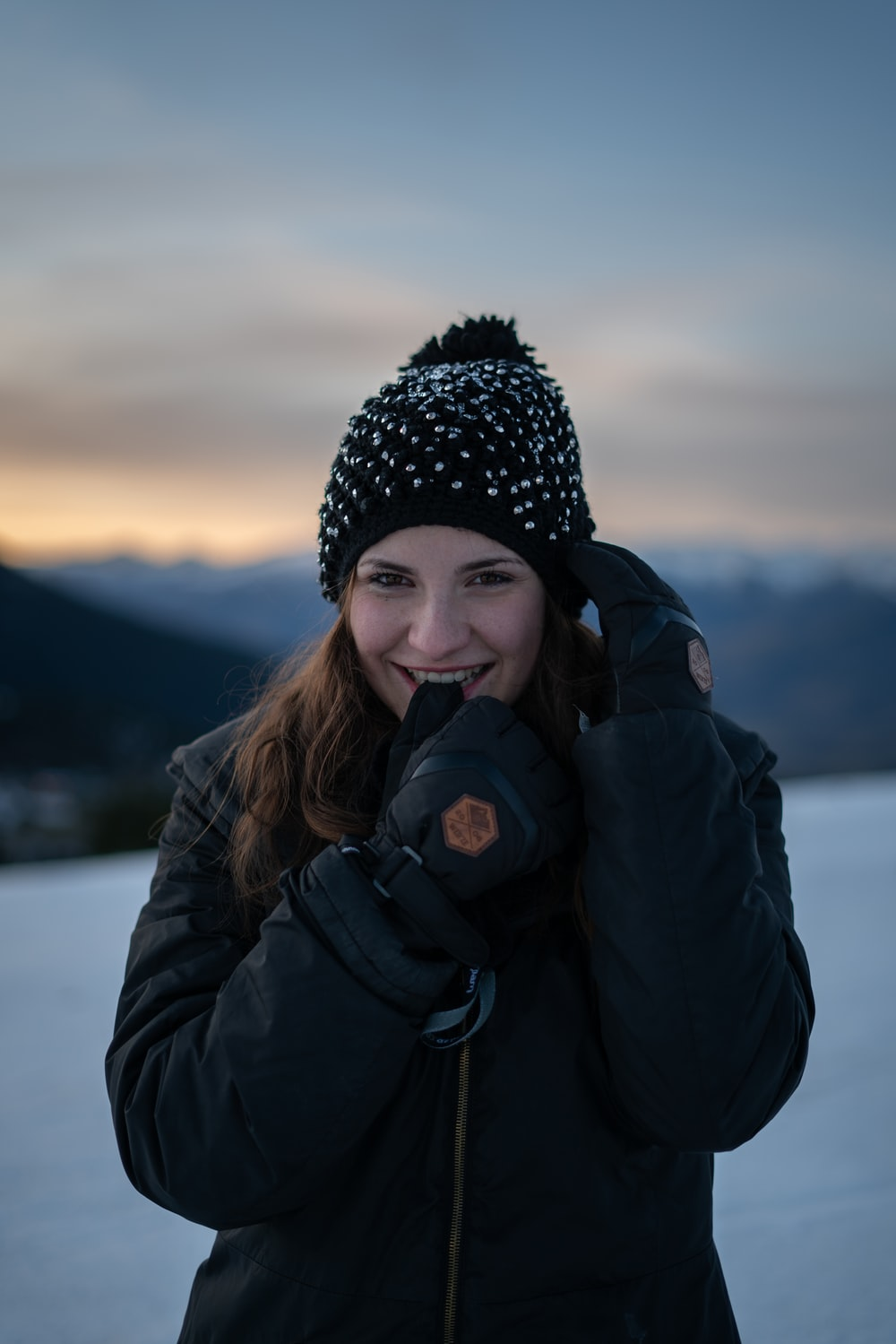 woman smiling on snowfield during day