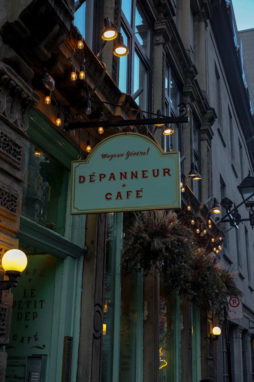 shallow focus photo of depnneur cafe sigange