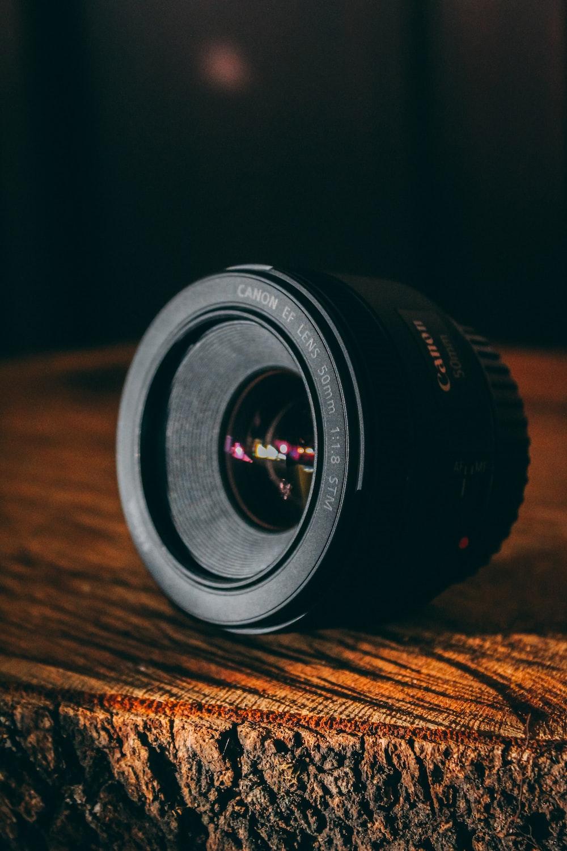 shallow focus photo of black Canon DSLR camera lens