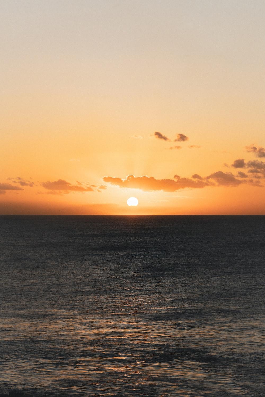blue ocean during golden hour
