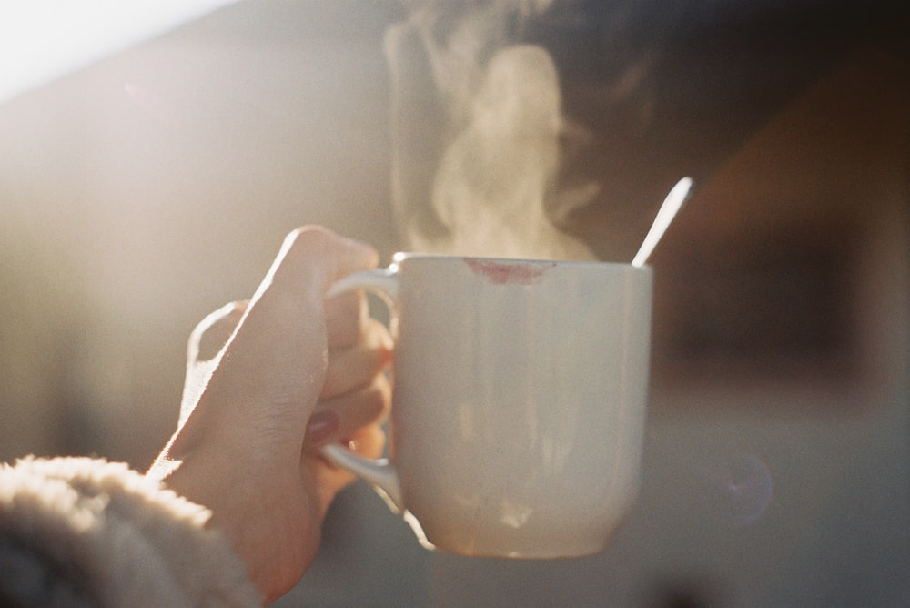 time-lapse photography of smoke from a white ceramic coffee mug