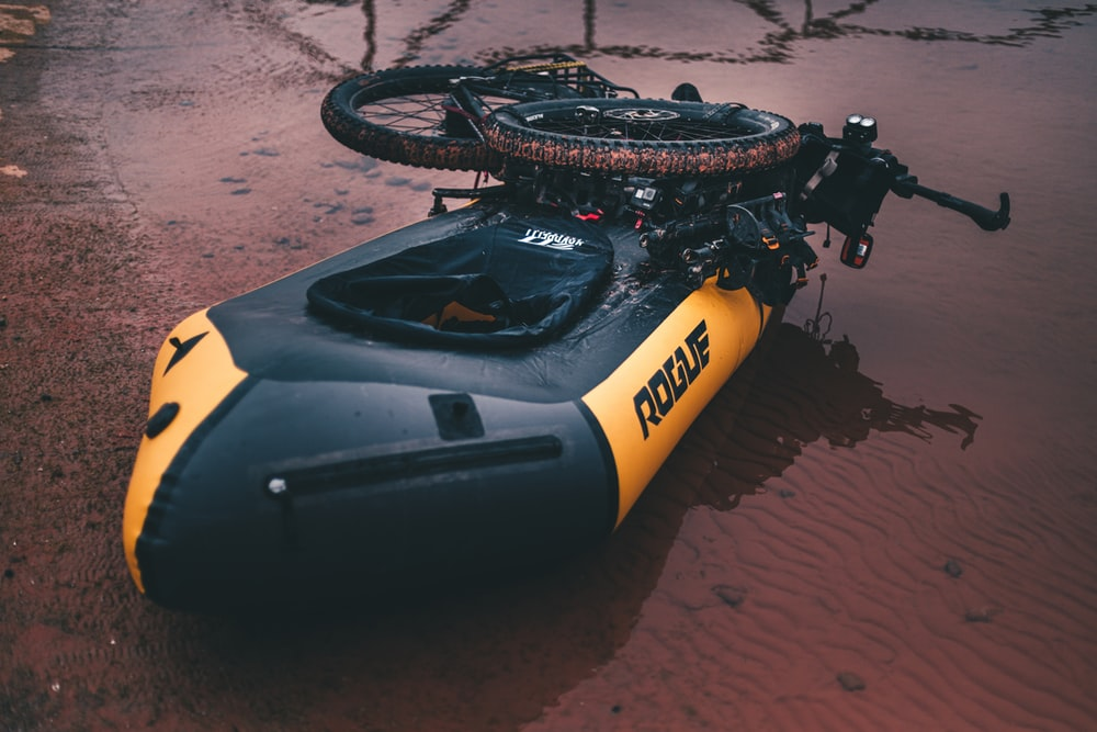 yellow and black Rogue inflatable boat