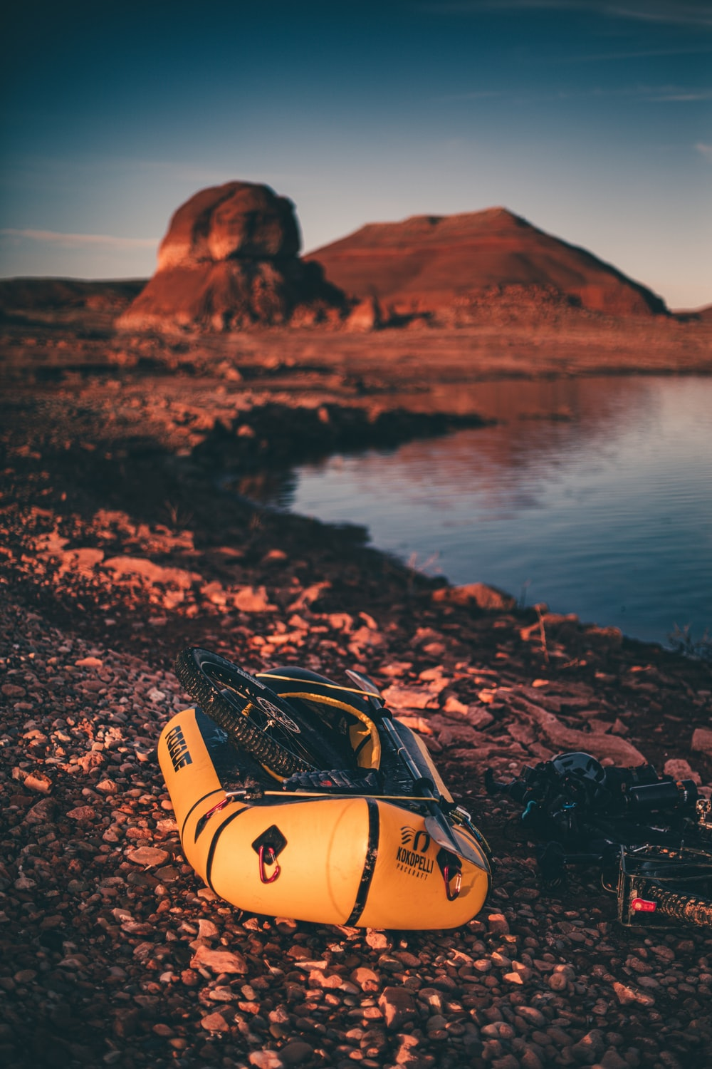black and yellow inflatable raft near body of water