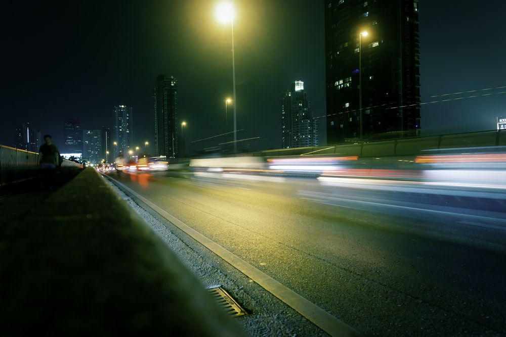 long-exposure photograph of road at night