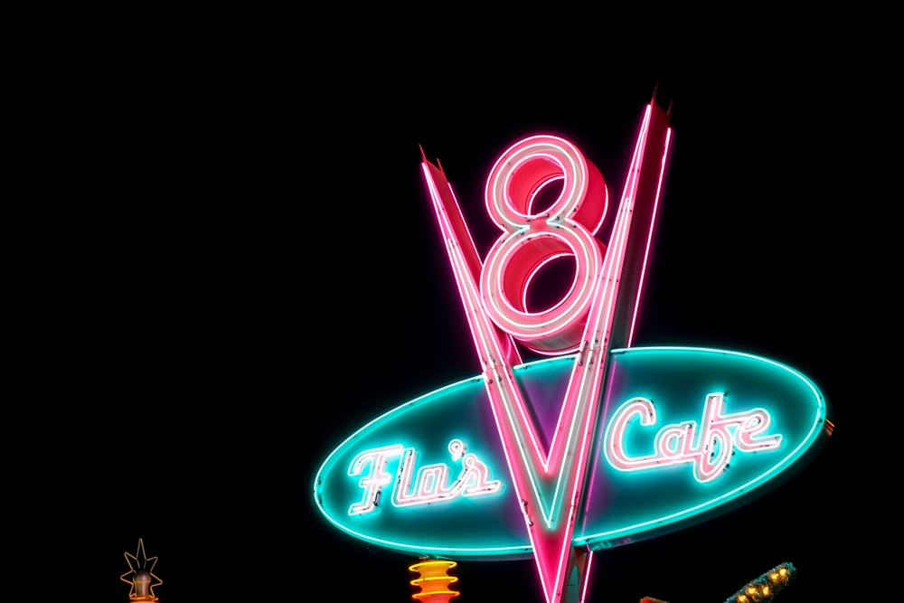 Flu's Cafe neon sign at night
